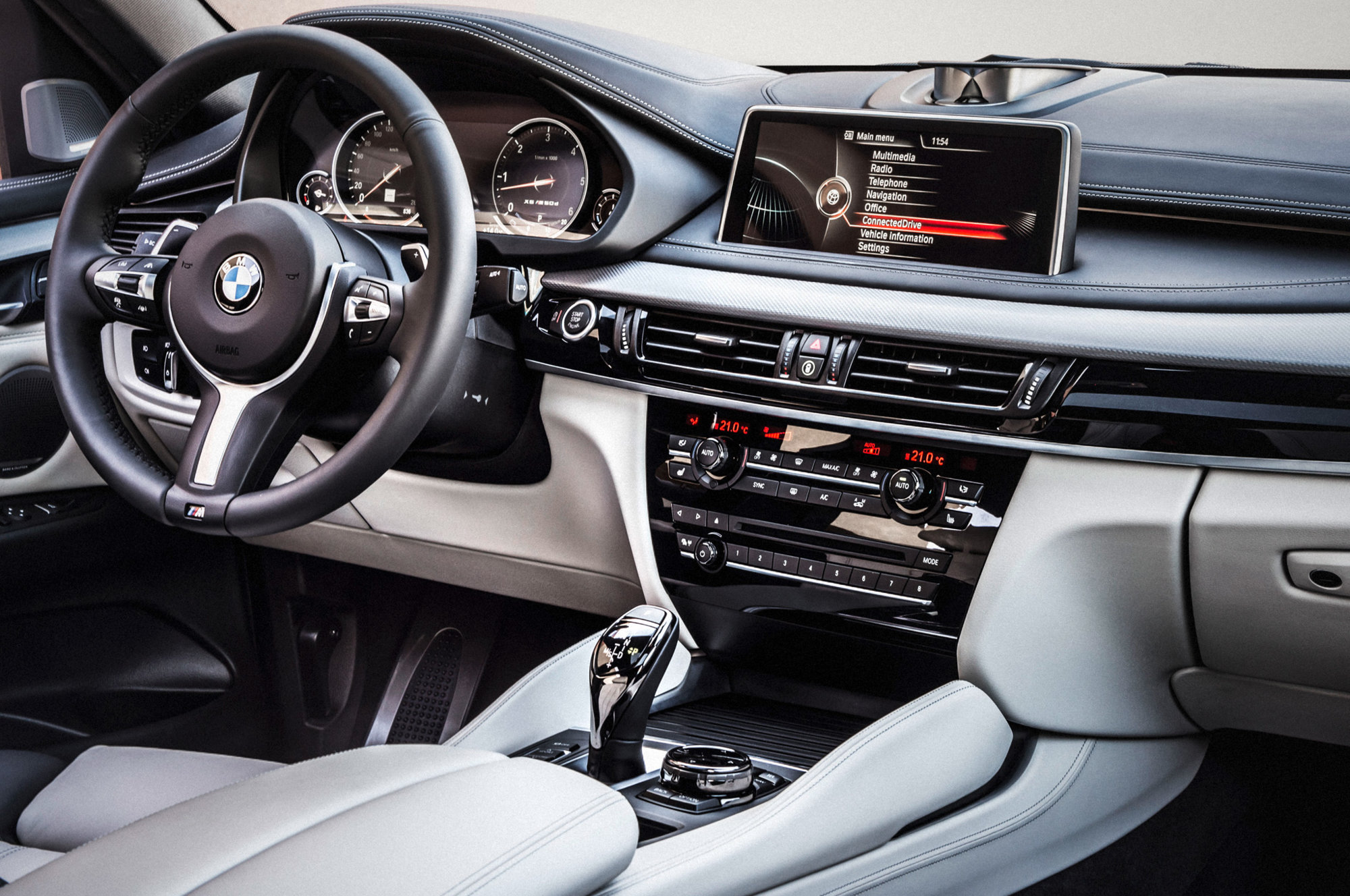 2015-bmw-x6-interior-from-passenger-side.jpg