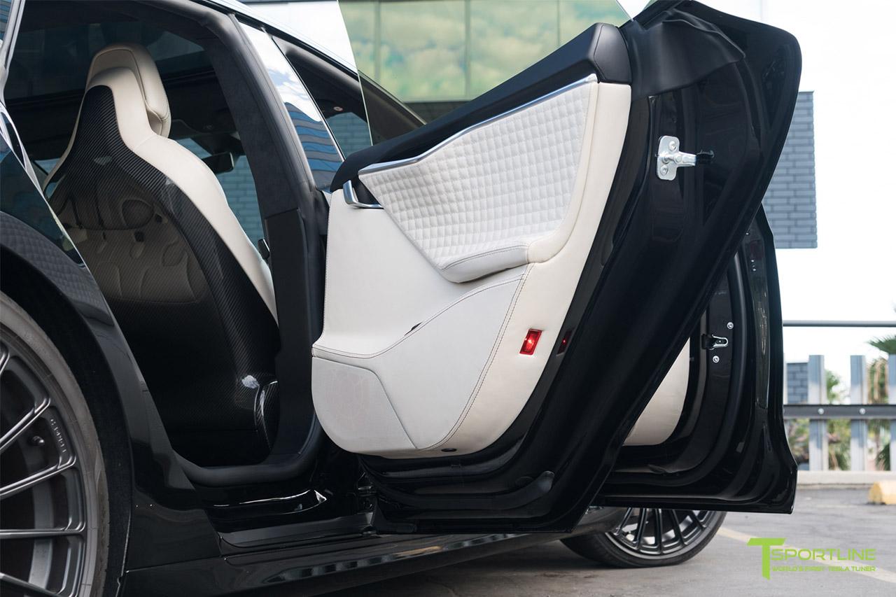 27 black-tesla-model-s-custom-interior-bentley-linen-gloss-carbon-fiber-seatbacks.jpg