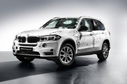 bmw-x5-security-front-three-quarters-with-bullets.jpg