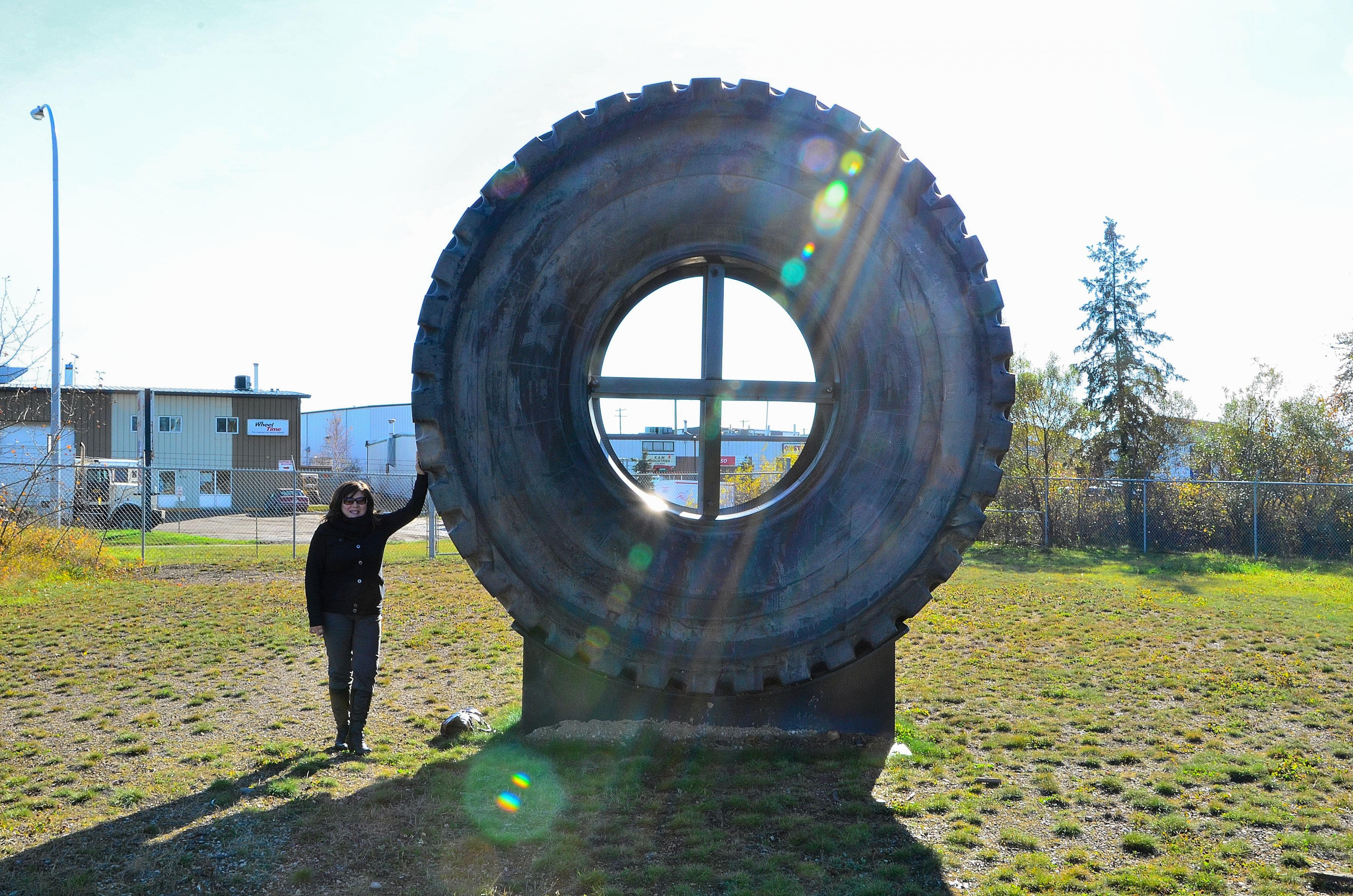 gail-with-a-caterpillar-797-tire-at-the-osdc.jpg