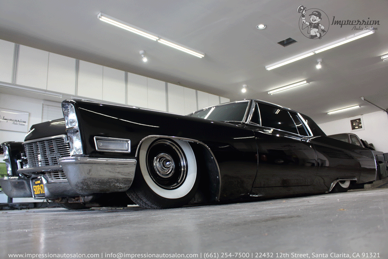 J-_Impression_Tesla-Motors-Club-Posts_Tesla-Forum---Introduction_Low-Shot-of-Black-Cadillac.png