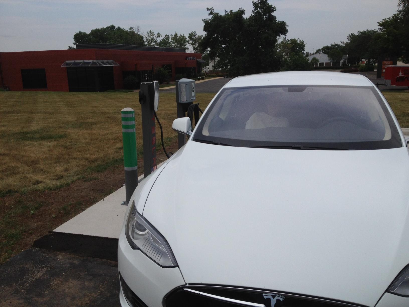 Tesla at charger.JPG