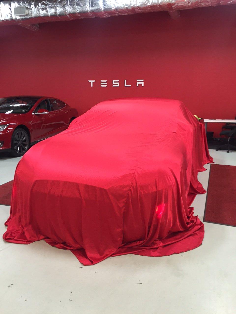 Tesla-At-Delivery.jpeg