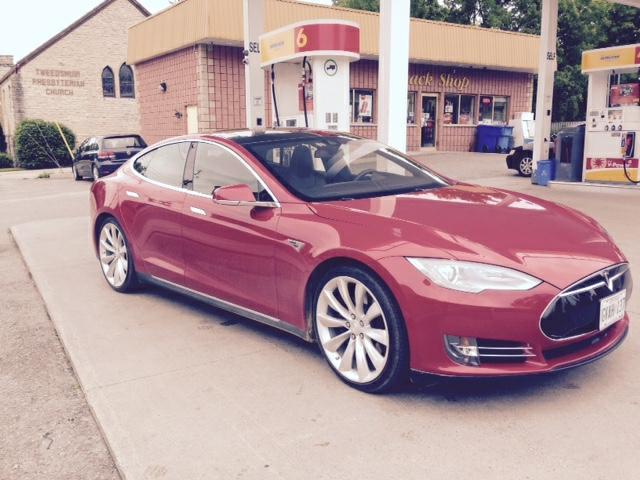 Tesla at gas station.jpg