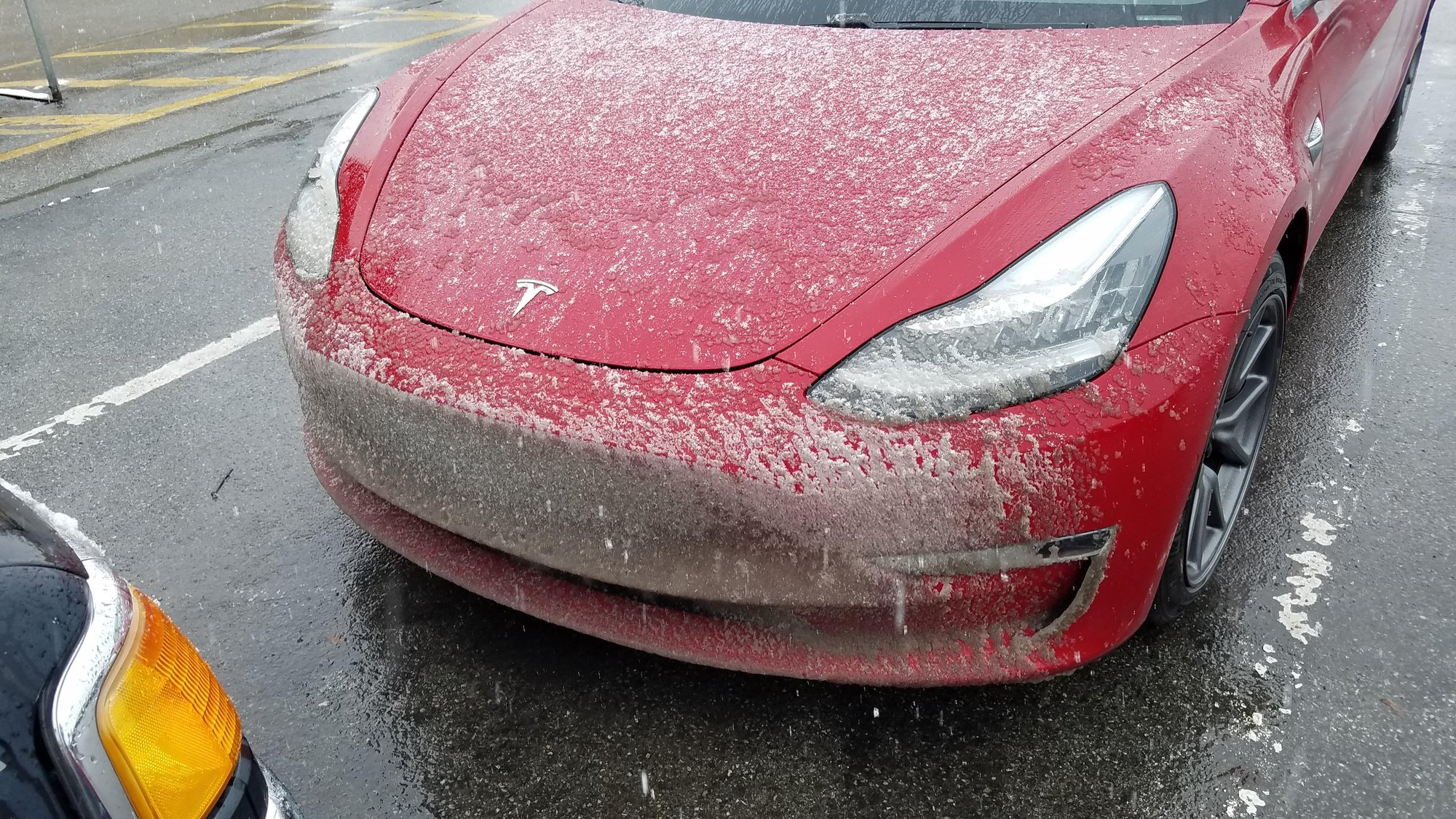 Tesla Model 3 front end covered with snow.jpg