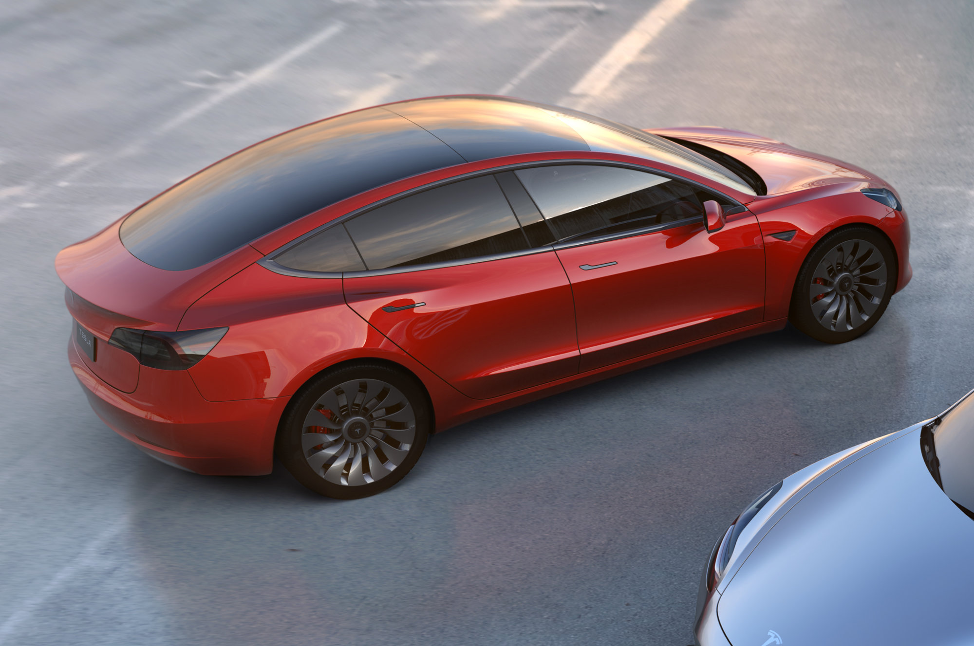Tesla-Model-3-rear-side-view-from-above-in-red.jpg