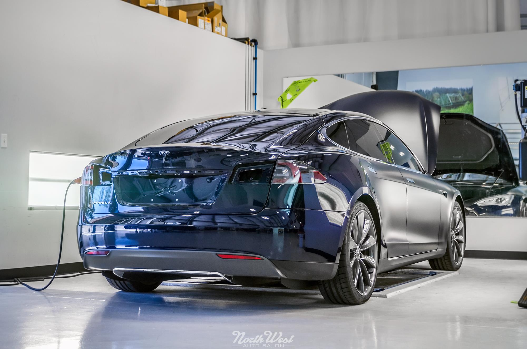 tesla-model-s-signature-wrapped-satin-xpel-stealth-paint-protection-clear-bra-installing.jpg
