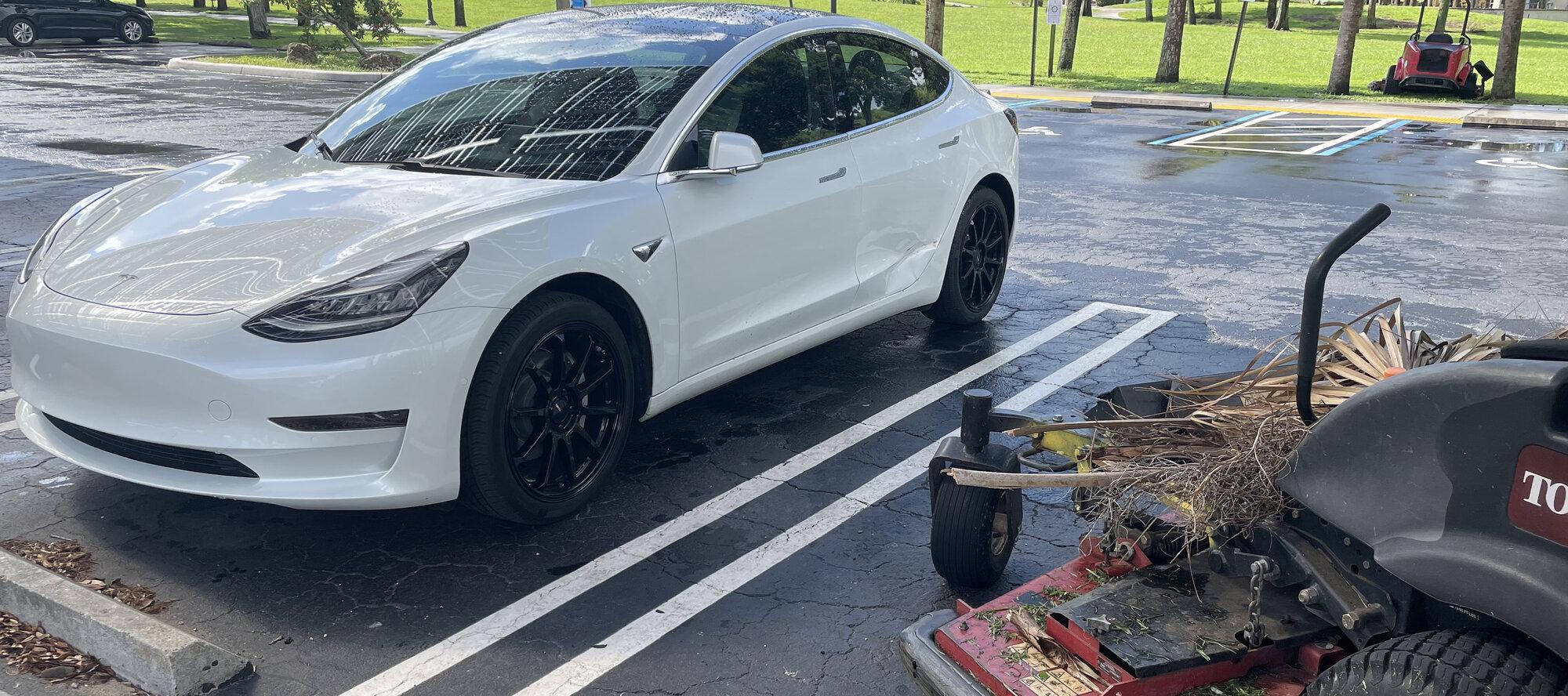 Tesla parked lawnmower.jpeg