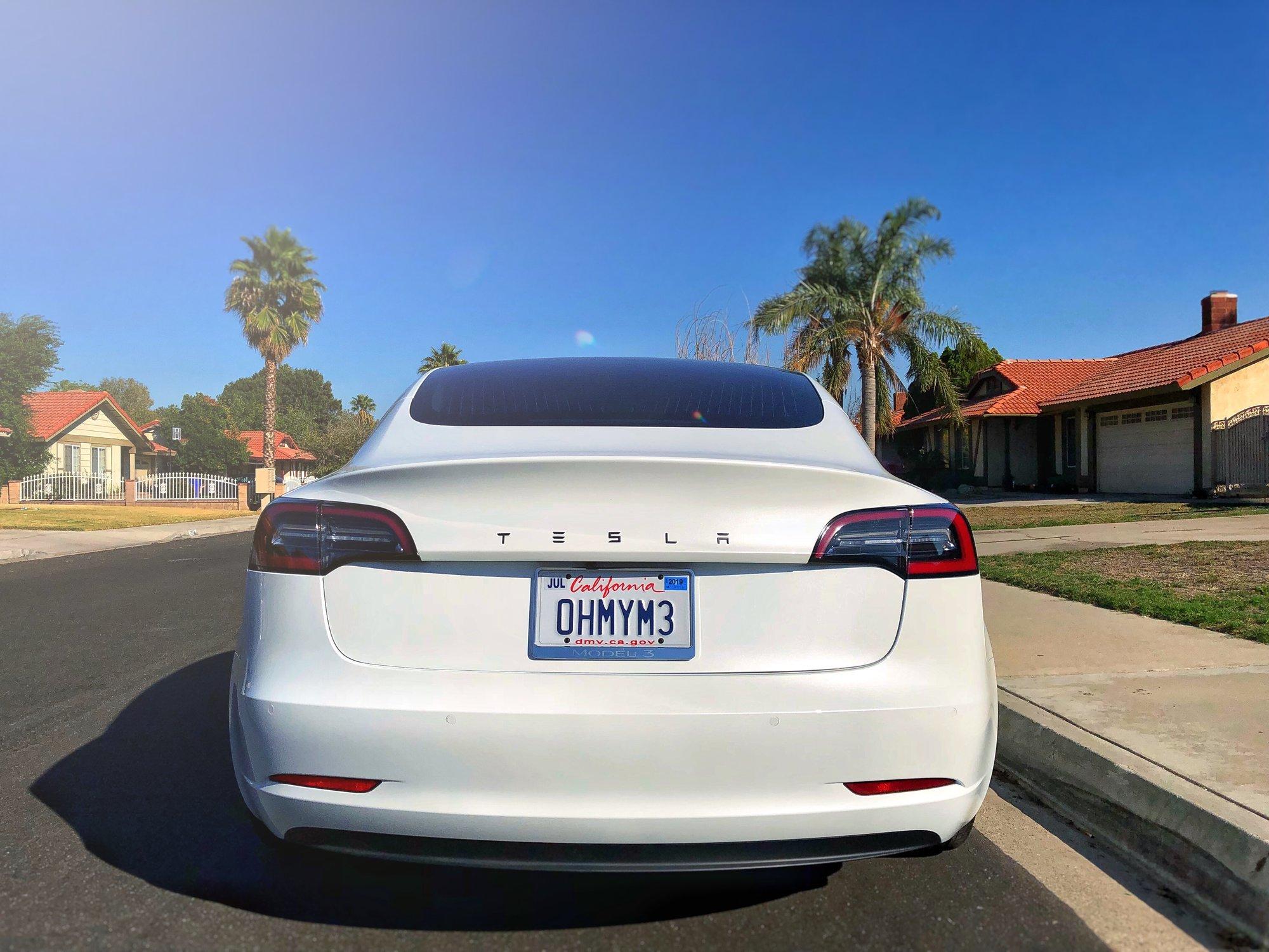Tesla_Emblem_Wide.jpg