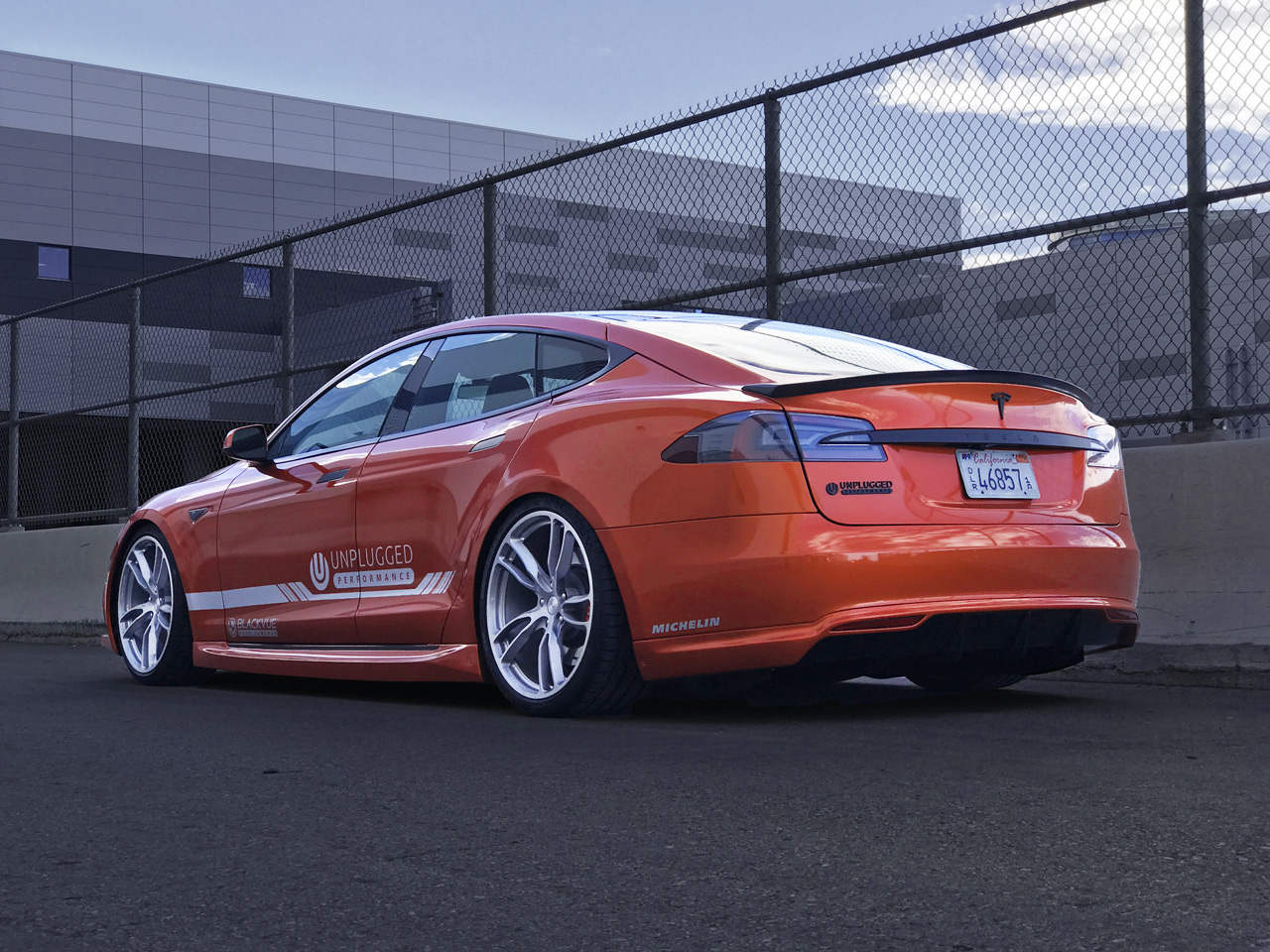 Unplugged-Performance-Model-S-Demo-Car-Orange---Rear-3-4.jpg